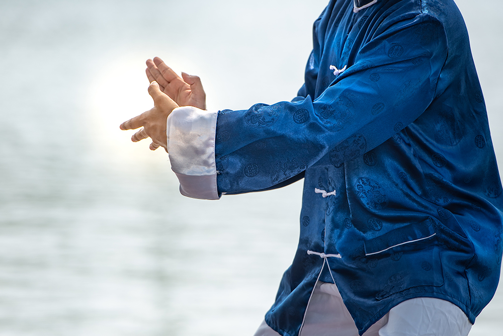Young man practicing traditional Tai Chi
