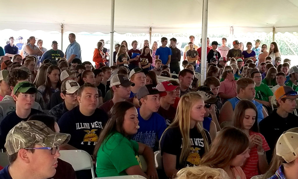Students in a livestock judging competition crowd