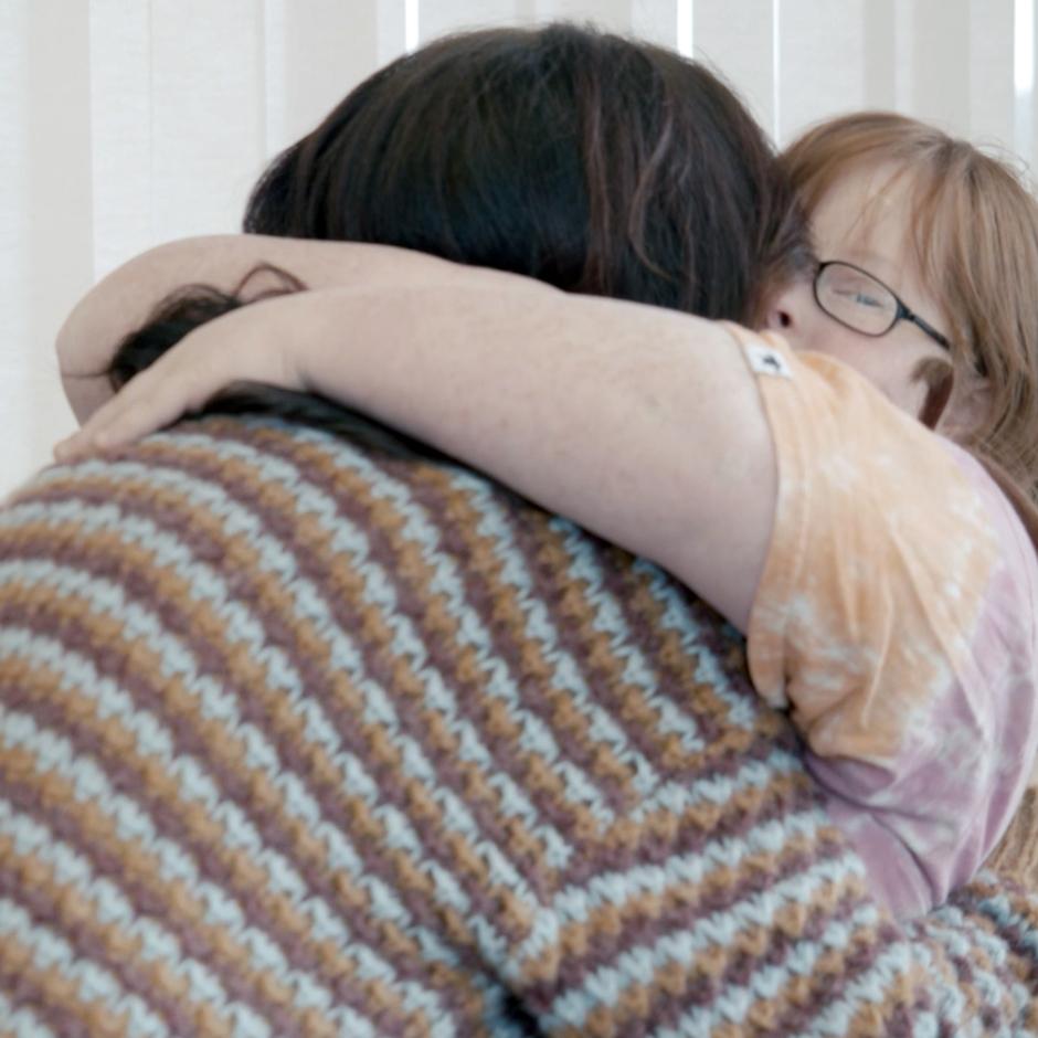 CFL student hugging