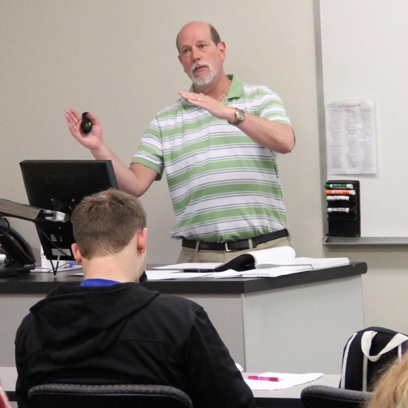 male professor teaching class