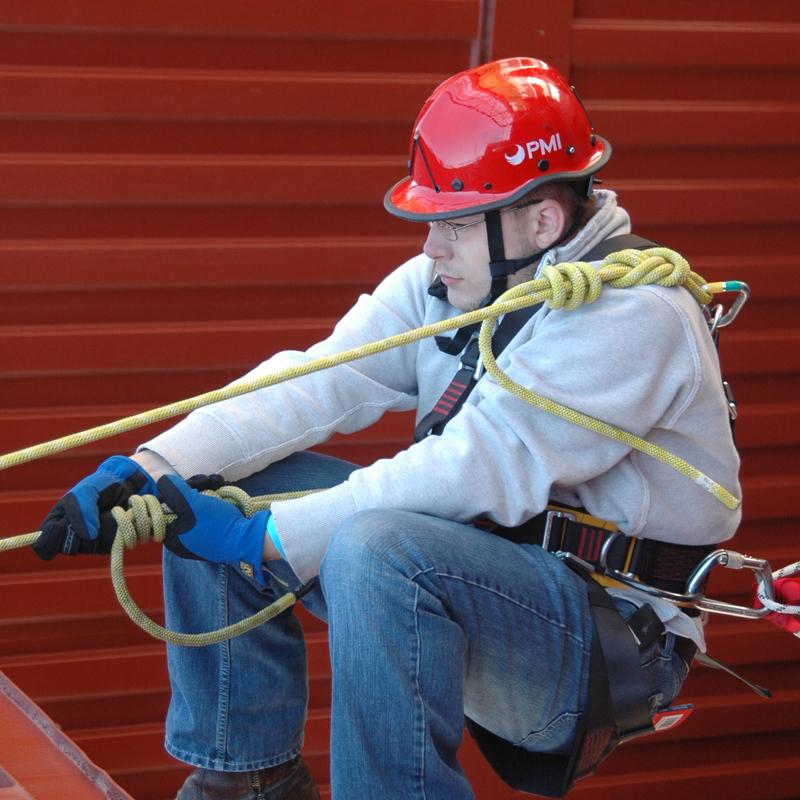 Fireman pulling heavy gear