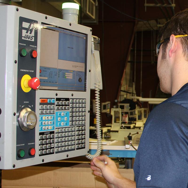 student standing next to machine