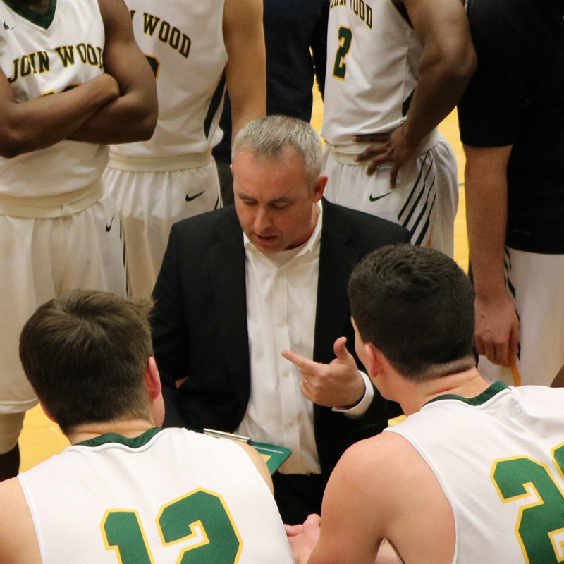 Sports coach talking to the players