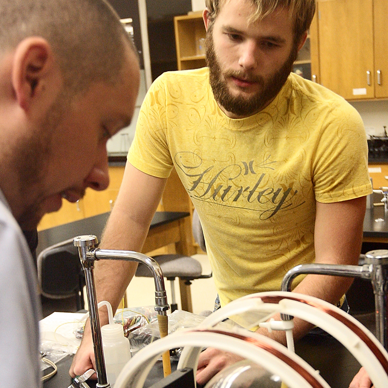 two male students in a college lab
