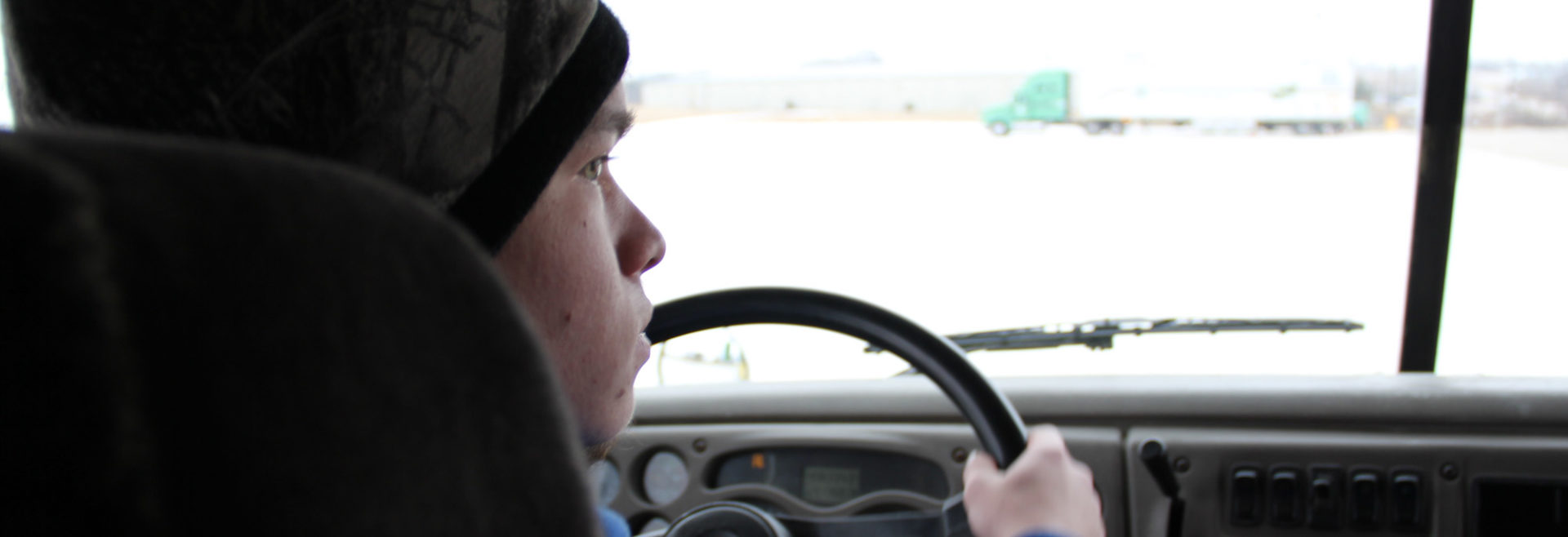 student driving a truck