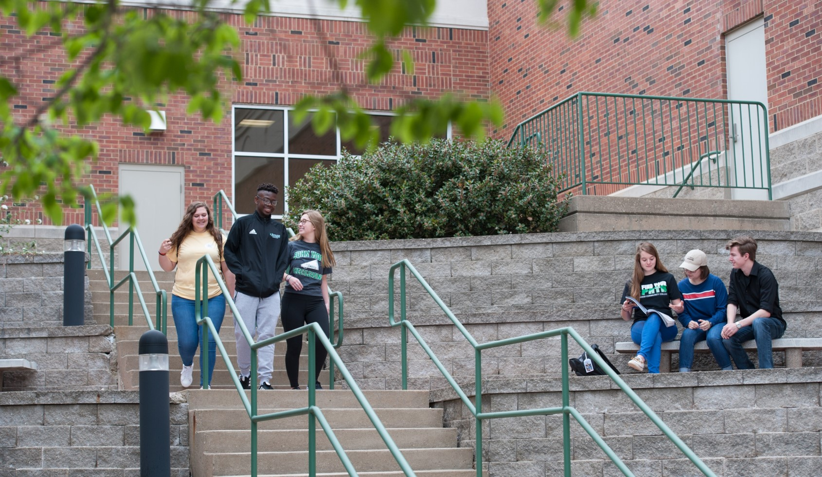 JWCC students walk down outside stairs on main campus