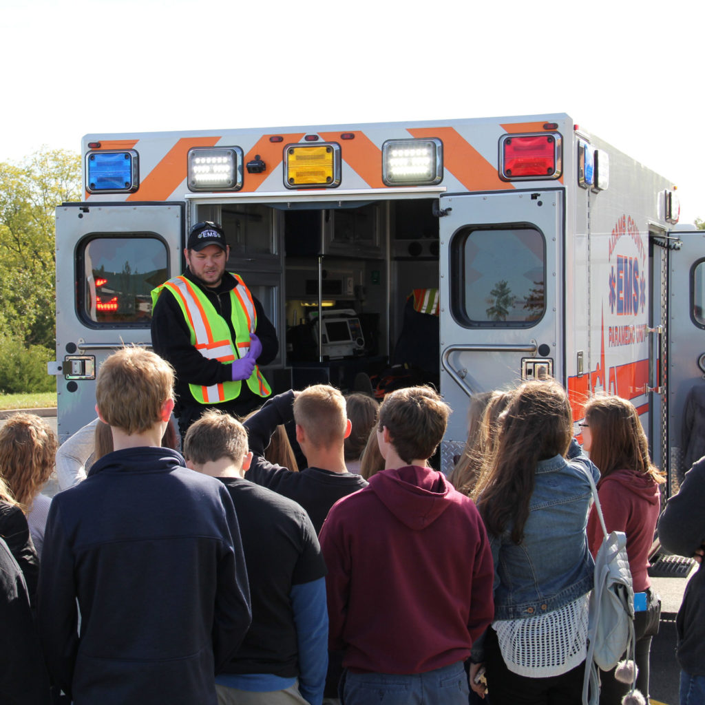 group of student next to an ambulance