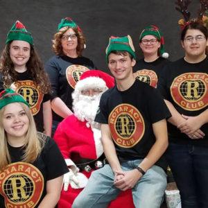 Rotaract Club students sit on Santa's lap