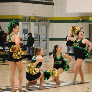 JWCC Blazerettes dancing at a basketball game