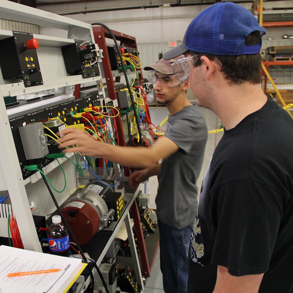 two male students working with wires