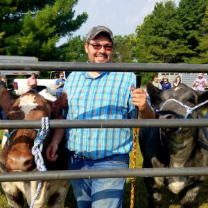 Student judging two cows