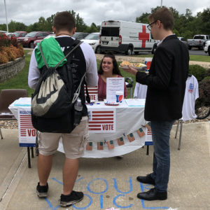 Students meet at the College Republicans booth at a Blazer BBQ