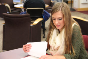 Student looks over her notes in the library