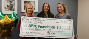 2020 Career Makeover winner Ashley Sparks receives award from Natalie Will from WGEM and Barb Holthaus from the JWCC Foundation.