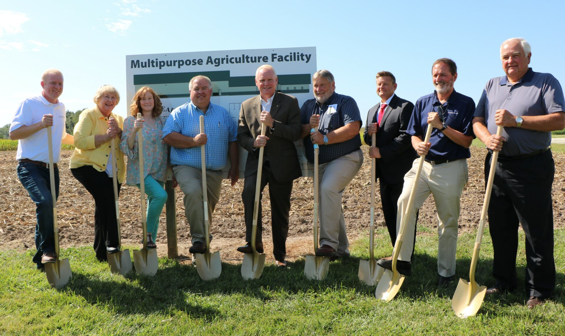 Several JWCC trustees pose with shovels in new Orr Building groundbreaking session