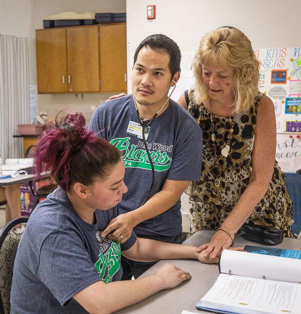 CNA Student and teacher using stethoscope