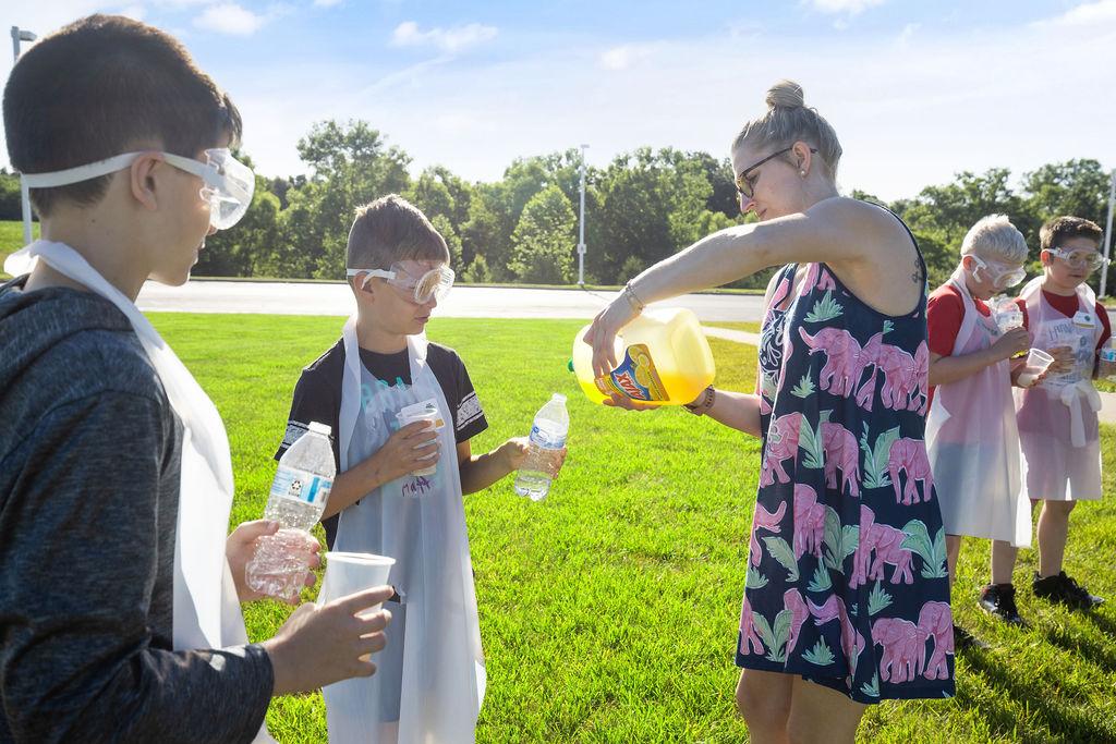 JDub Academy students pour liquids outside for fun experiment