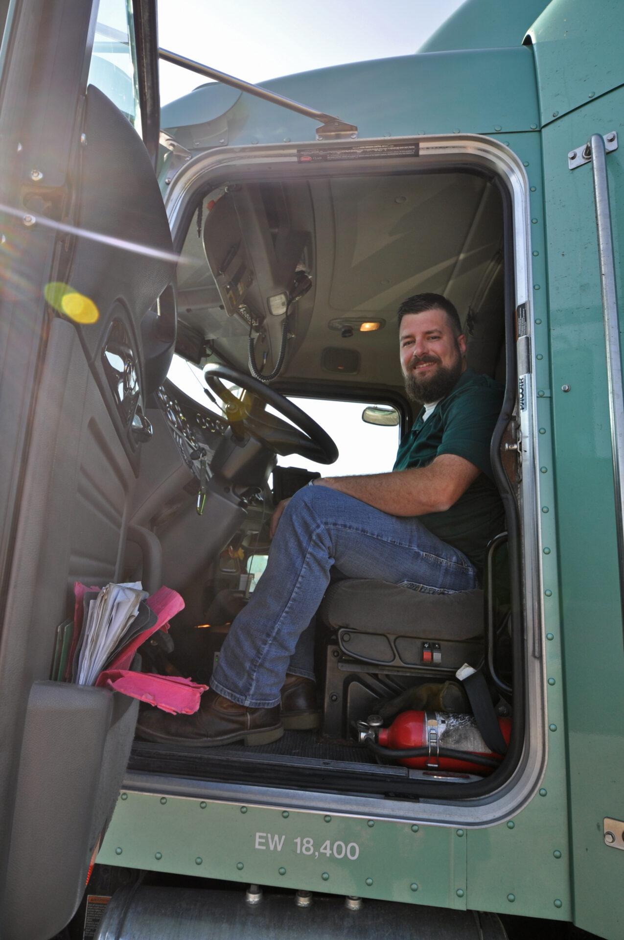 Luke Lish sitting in a semi truck.