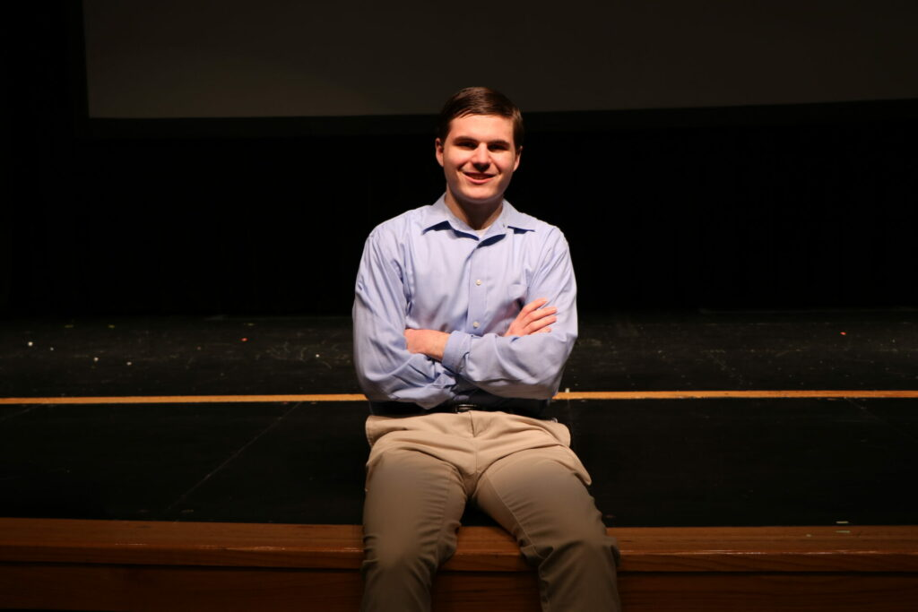 Evan Conover sitting on the stage