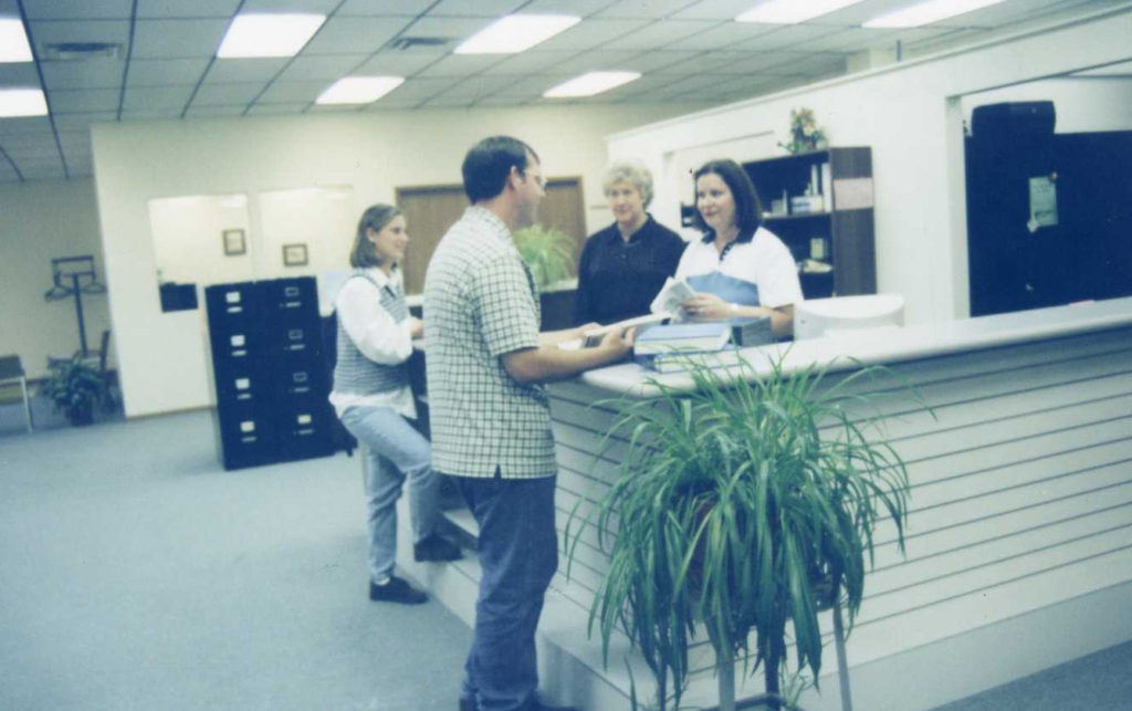 Early picture of the Pittsfield Education Center front desk